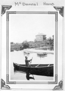 Photo of an unknown young canoeist circa 1925. The house in the background was home to the McDonnell family. Present day Killaloe was once known as Fort McDonnell, named after it's first settlers. Pearl Murack Collection.