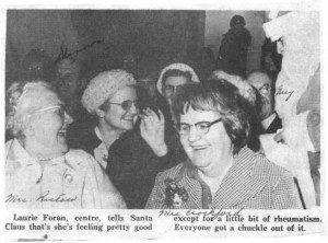 Laurie Foran and friends share a laugh with Santa Claus during winter Carnival. Betty Mullin Collection.