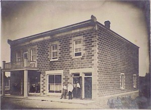 This building which still stands on Lake Street has been home to many businesses including Strack's Harness Shop and Cybulski's Barbershop. Pearl Murack Collection.
