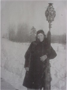 unidentified woman with a light post