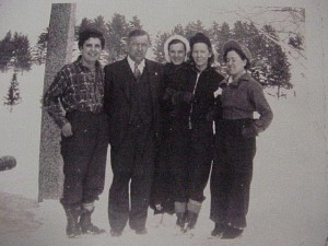 unknown family outside in the snow