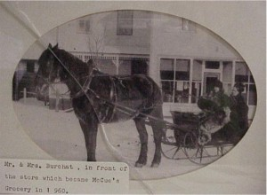 Mr. & Mrs. Burchat in front of the store which became McCue's Grocery in 1960.