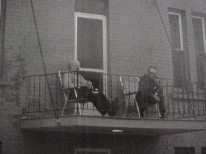 two gentlemen on porch downtown killaloe unknown