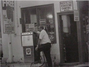 unidentified man by gas pump