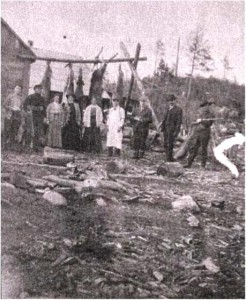 unidentified men , probably at J.R logging