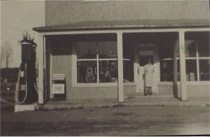 unidentified person outside store front Killaloe